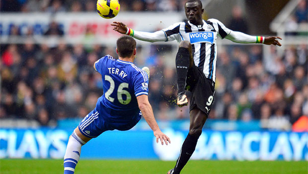 Chelseas-John-Terry-left-and-Newcastle-Uniteds-Papiss-Cisse-battle-for-the-ball