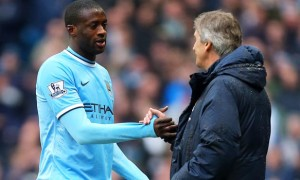 Yaya Toure and Manuel Pellegrini Manchester City