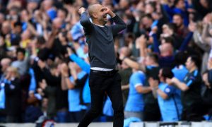 Manchester City manager Pep Guardiola celebrates a goal during the Premier League match at Etihad